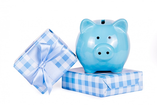 Gift boxes and piggy bank. money for gift. gifts and shopping