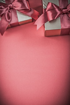 Gift boxes on red background close up view holidays concept