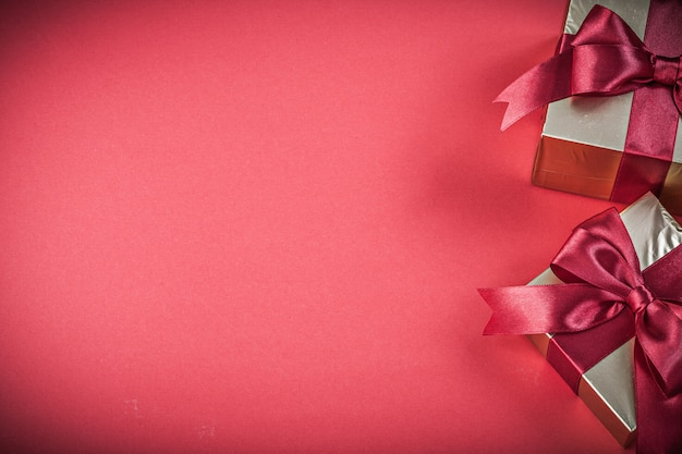 Gift boxes on red background copyspace holidays concept