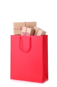 Gift boxes in red paper bag isolated