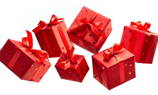 Gift boxes in red paper tied with satin ribbons with bows