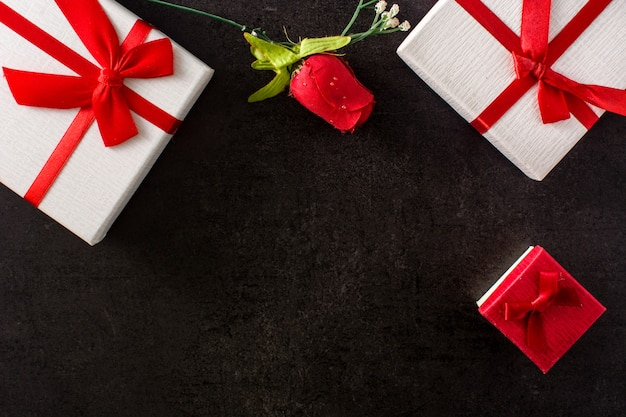 Gift boxes and red rose
