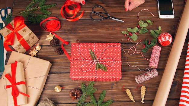 Gift boxes, ribbon bows,tissue paper and scissors. getting ready for xmas