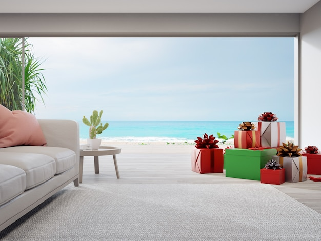 Gift boxes and sofa on wooden floor of bright living room in modern beach house