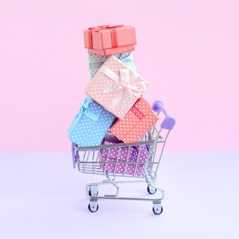 Gift boxes for winter holidays in supermarket shopping cart