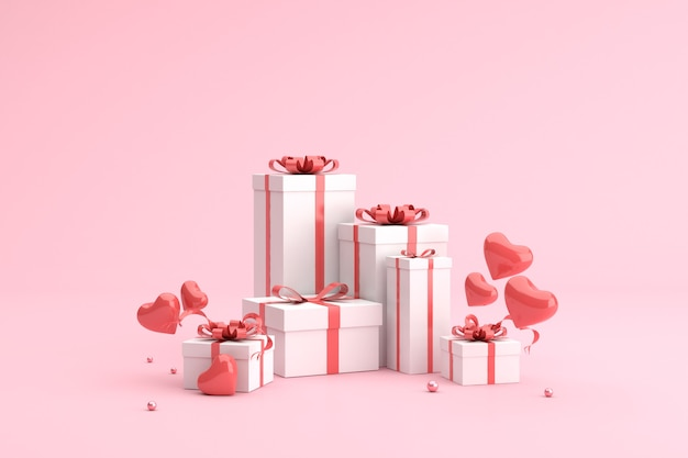 Gift boxes with balloons in heart shape.