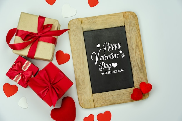 Gift boxes with blackboard with valentine's day greeting