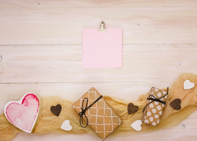 Gift boxes with blank paper and red heart