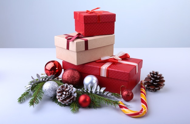 Gift boxes with bow and christmas balls on wood background