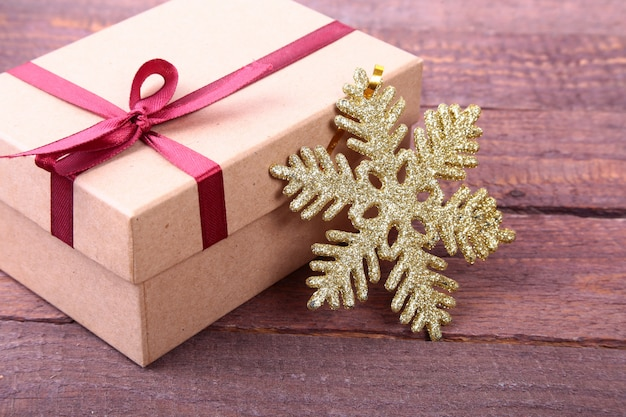 Gift boxes with bow and christmas decoration on wood surface
