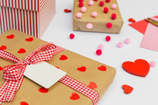 Gift boxes with red heart on table