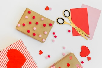 Gift boxes with red hearts and envelopes on table