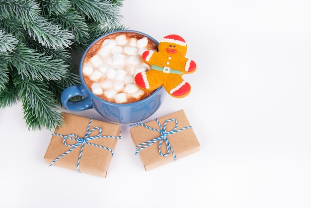 Gift boxes with ribbons and hot chocolate with marshmallows