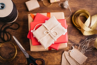 Gift boxes with ribbons on wooden table
