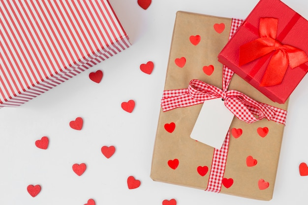 Gift boxes with small hearts on light table