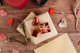 Gift boxes with small hearts on wooden table