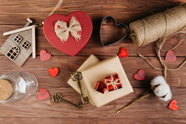 Gift boxes with small hearts on table