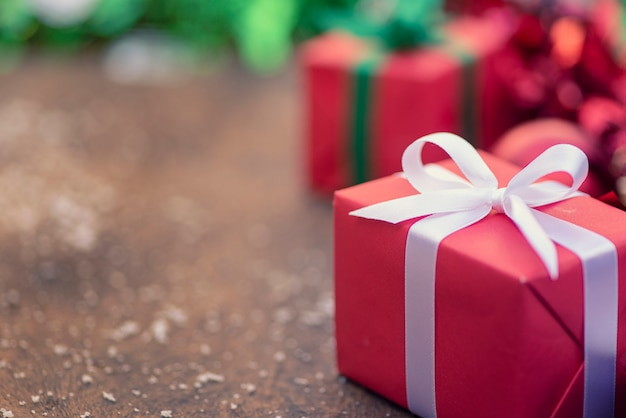 Gift boxes with a white bow against a background bokeh of twinkling