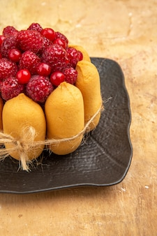 Gift cake with fruits on the right side of mixed color table