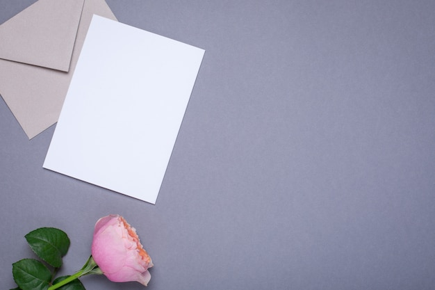 Gift card and envelope with pink rose on gray