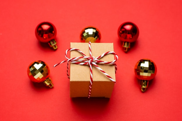 Gift and christmas decor on a colored red background.