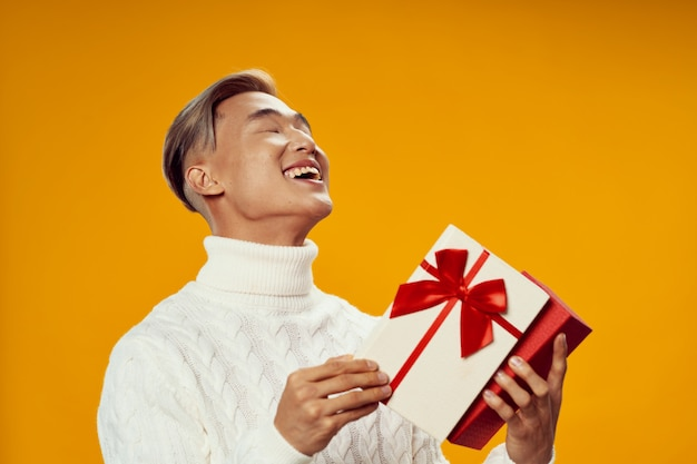 Gift for christmas man in white sweater joy holiday lifestyle fun yellow