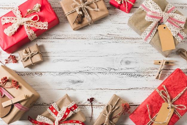 Gift frame on wooden background
