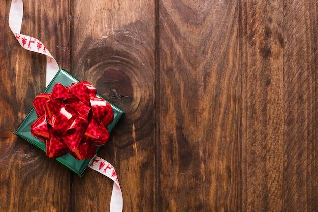 Gift lying on christmas ribbon