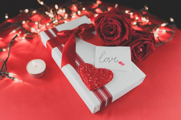Gift pack with a heart and roses on top
