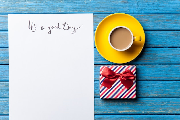 Gift and paper with good day inscription