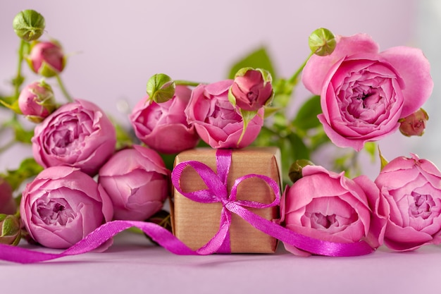 Gift present box with beautiful pink flowers roses bouquet. concept mother's day.