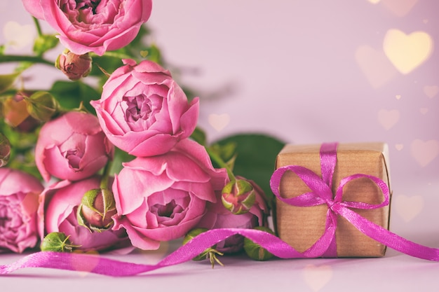 Gift present box with beautiful pink flowers roses bouquet. concept mother's day