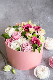 Gift set in the box - white and pink marshmallows and beautiful flowers