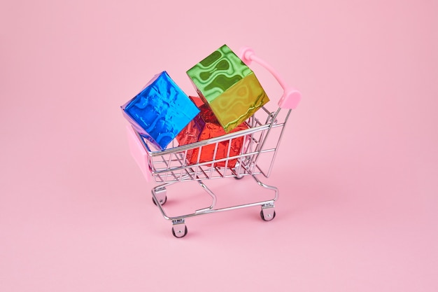 Gift shopping shopping cart is full of colourful gift boxes concept online shopping
