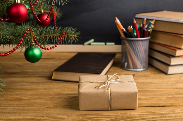 Gift teacher's table with books, organizer and chalkboard. the concept of christmas and new year.