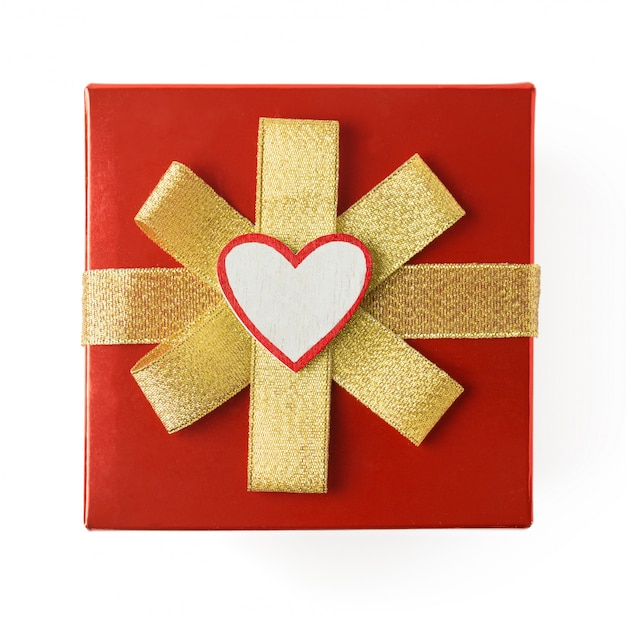 Gift for valentine's day, wrapped in red wrapping paper with gold