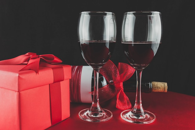 Gift with a bottle of wine and two glasses with red wine