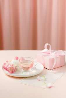 Gift with flowers and a cup of tea -  anniversary day