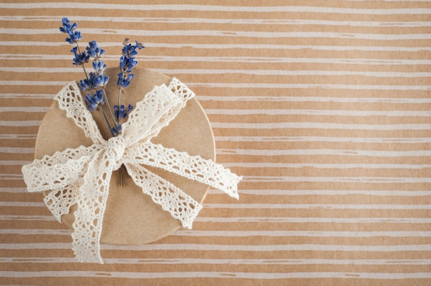 Gift with lace bow, lavender flower