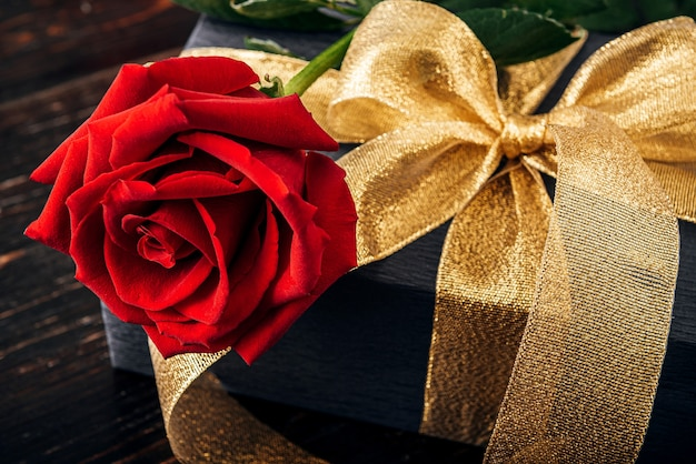Gift wrapped in black paper and a gold ribbon