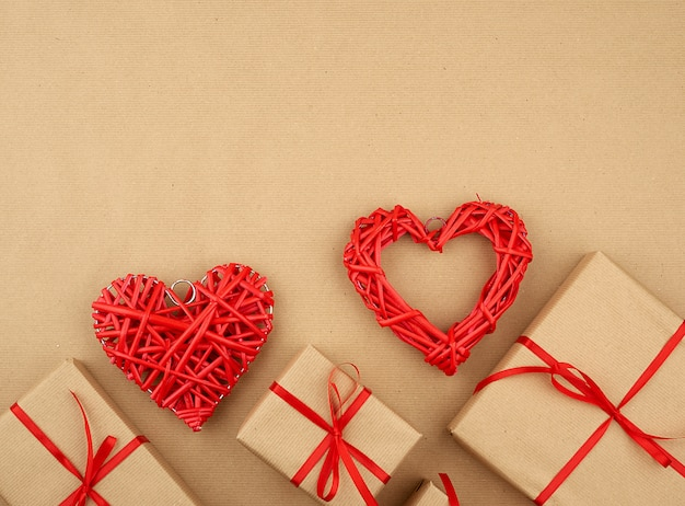 Gift wrapped in brown kraft paper and tied with a thin silk ribbon