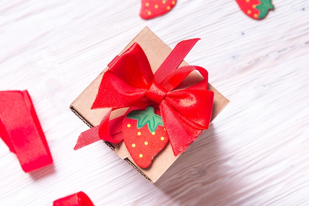 Gift wrapped cardboard box on wooden table