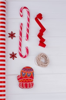 Gift wrapping accessories on wooden background preparing for winter holidays