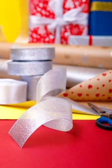 Gift wrapping, boxes, paper, ribbon and scissors