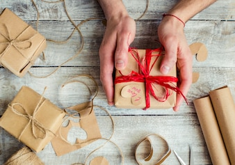 Gift wrapping for the beloved. Selective focus.