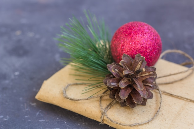 Gift wrapping in kraft paper with christmas decoration