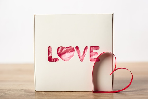 Gift wrapping for a loved one. valentine's day concept. banner.