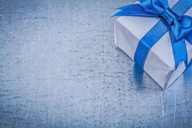 Giftbox on metallic table,