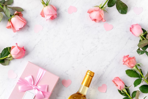 Giftbox and pink rose flower on marble white table background for valentine's day holiday gift design concept concept.