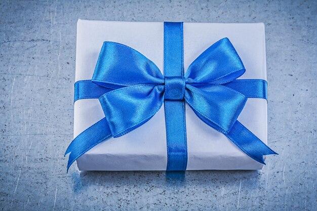 Giftbox present tape on metallic table